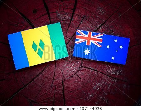 Saint Vincent And The Grenadines Flag With Australian Flag On A Tree Stump Isolated
