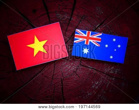 Vietnamese Flag With Australian Flag On A Tree Stump Isolated