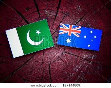 Pakistan Flag With Australian Flag On A Tree Stump Isolated