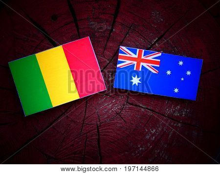 Malian Flag With Australian Flag On A Tree Stump Isolated