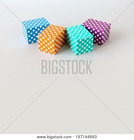 Colorful blocks polka dot pattern. Violet green orange blue color rectangular abstract boxes arranged on gray background. geometrical design concept.