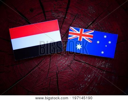 Yemeni Flag With Australian Flag On A Tree Stump Isolated