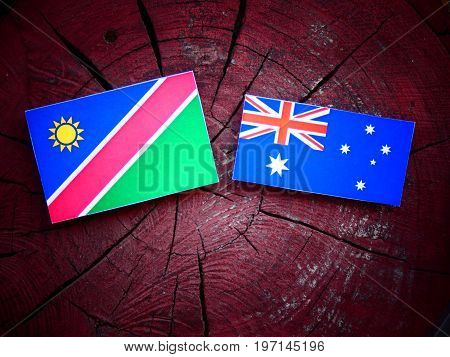 Namibian Flag With Australian Flag On A Tree Stump Isolated