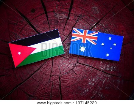 Jordanian Flag With Australian Flag On A Tree Stump Isolated
