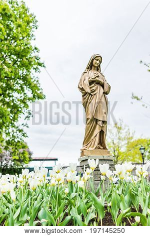 Quebec City, Canada - May 30, 2017: View Of Seminary Parking Lot With Golden Statue Of Mary And Whit