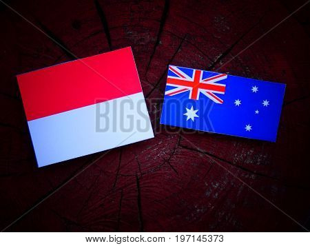 Monaco Flag With Australian Flag On A Tree Stump Isolated
