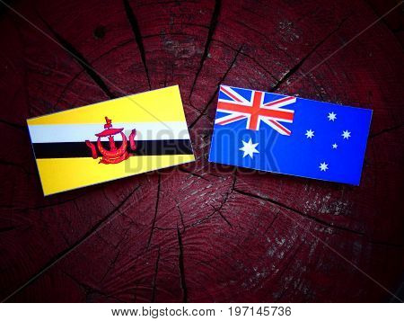 Brunei Flag With Australian Flag On A Tree Stump Isolated