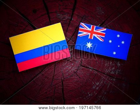 Colombian Flag With Australian Flag On A Tree Stump Isolated
