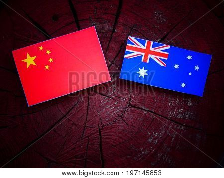 Chinese Flag With Australian Flag On A Tree Stump Isolated