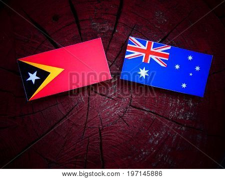 East Timorese Flag With Australian Flag On A Tree Stump Isolated