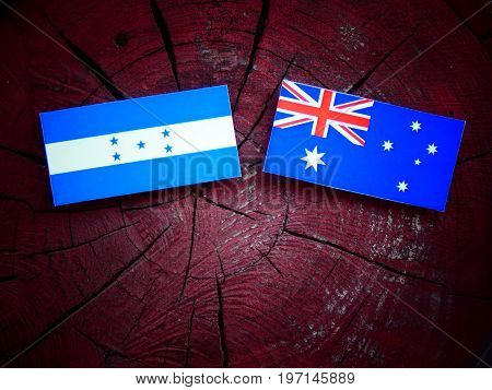 Honduran Flag With Australian Flag On A Tree Stump Isolated