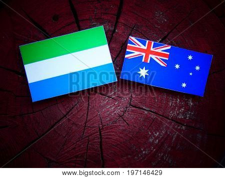 Seirra Leone Flag With Australian Flag On A Tree Stump Isolated