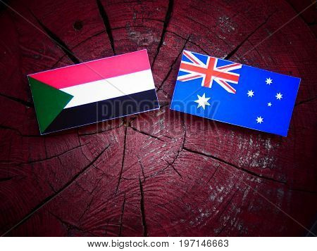 Sudan Flag With Australian Flag On A Tree Stump Isolated