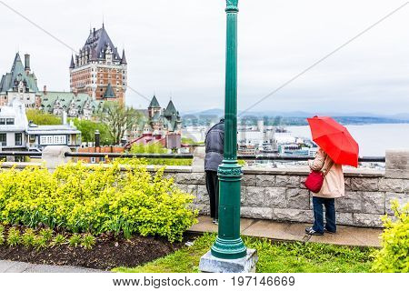 Quebec City, Canada - May 30, 2017: People With Red Umbrella Looking At Chateau Frontenac At Overloo