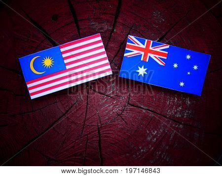 Malaysian Flag With Australian Flag On A Tree Stump Isolated