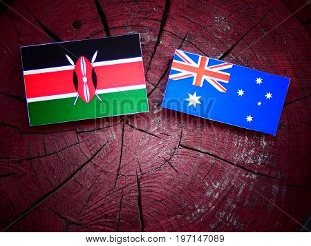 Kenyan Flag With Australian Flag On A Tree Stump Isolated