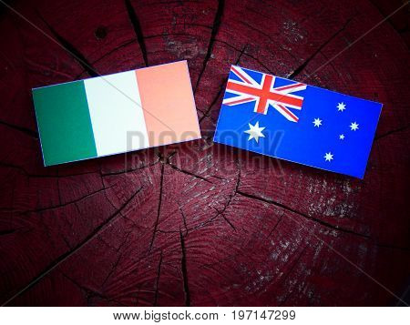 Irish Flag With Australian Flag On A Tree Stump Isolated
