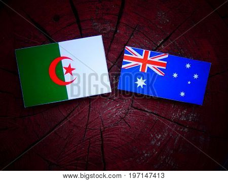 Algerian Flag With Australian Flag On A Tree Stump Isolated