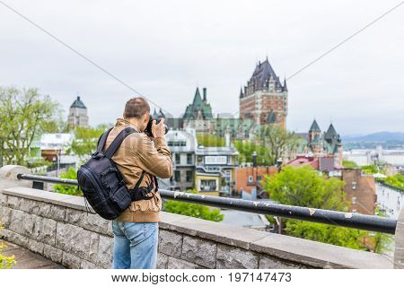Quebec City, Canada - May 30, 2017: Back Of Man Photographer Taking Pictures Of Chateau Frontenac At