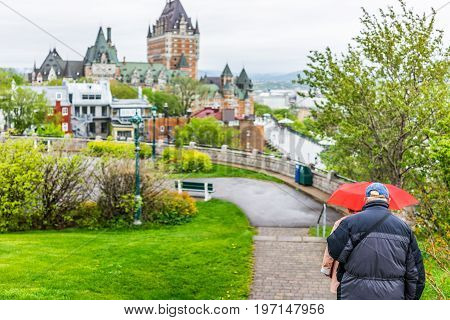 Quebec City, Canada - May 30, 2017: Couple Walking Down Steps Overlooking Chateau Frontenac, Dufferi