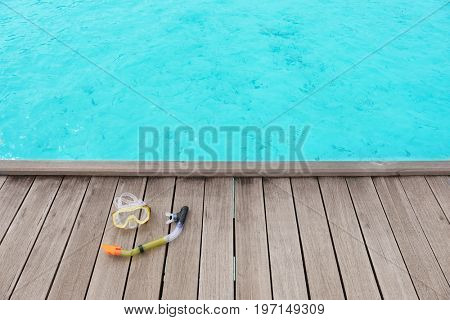 Accessories for snorkeling on wooden pontoon at sea resort. Summer vacation concept