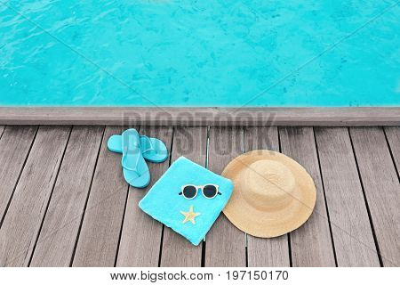 Beach accessories on wooden pontoon at sea resort. Summer vacation concept