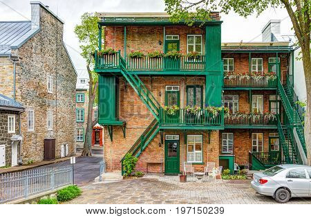 Quebec City, Canada - May 30, 2017: Closeup Of Old Town Residential Building With Balconies Decorate