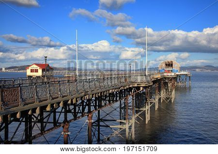 Swansea, Wales, UK - February 23, 2016:  Mumbles Pier in Swansea Bay which is a Victorian construction and a popular visitor attraction of the area