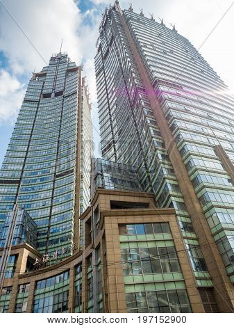 Shanghai, China - Nov 6, 2016: The Shanghai Clearing House on Zhongshan South Road. The building with modern architectural styling is in Huangpu District. Image taken from street level.
