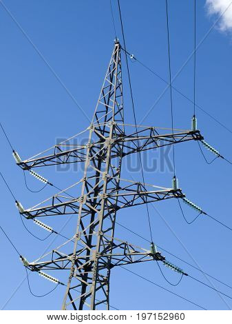 High-voltage tower supporting overhead power line wires