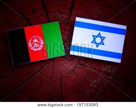 Afghani Flag With Israeli Flag On A Tree Stump Isolated