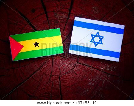 Sao Tome And Principe Flag With Israeli Flag On A Tree Stump Isolated