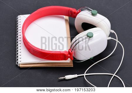 Modern And Stylish Earphones On Dark Background, Close Up