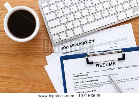 Resume On Work Desk Background
