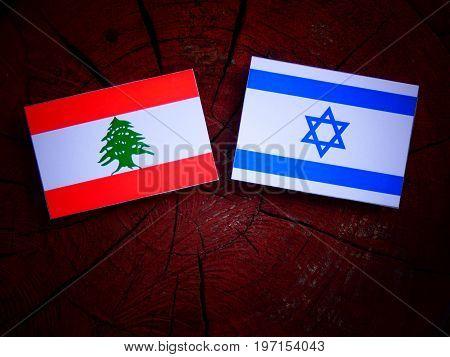 Lebanese Flag With Israeli Flag On A Tree Stump Isolated