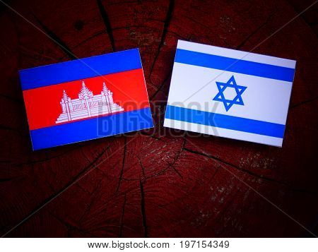 Cambodian Flag With Israeli Flag On A Tree Stump Isolated