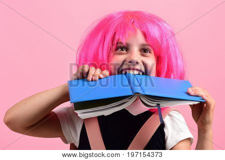 School Girl Bites Book With Happy Sight On Pink Background