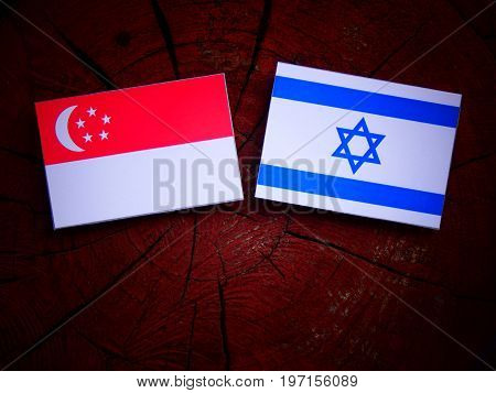 Singaporean Flag With Israeli Flag On A Tree Stump Isolated