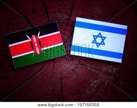 Kenyan Flag With Israeli Flag On A Tree Stump Isolated
