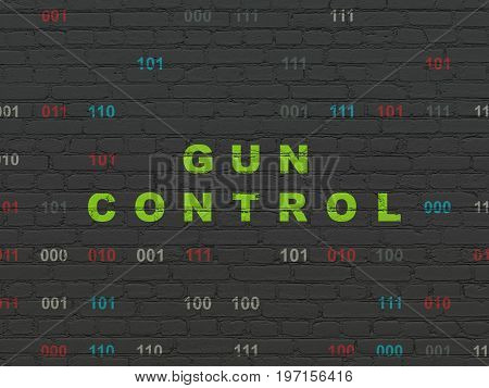 Safety concept: Painted green text Gun Control on Black Brick wall background with Binary Code