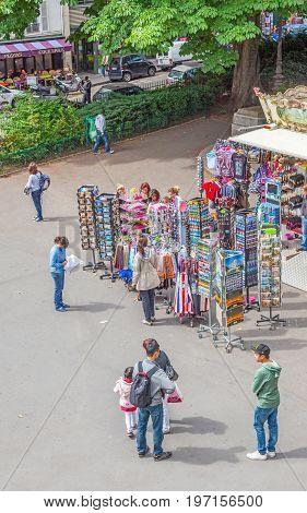 PARIS FRANCE - JUNE 6, 2012: Tourists at an outdoor souvenir shop in Montmartre in Paris.