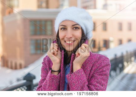 Smiling Girl In A Pink Coat