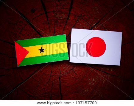 Sao Tome And Principe Flag With Japanese Flag On A Tree Stump Isolated