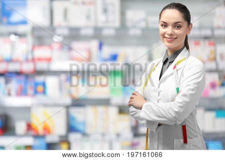 Nutritionist with measure tape at pharmacy