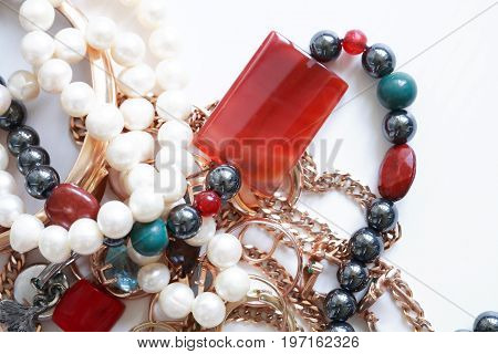 Set of various jewelry adornments on white background with free space