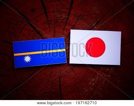 Nauru Flag With Japanese Flag On A Tree Stump Isolated