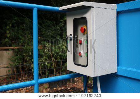 Electrical control box outside the building in the garden.