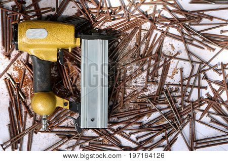 Air Nailer with rusty nail.Equipment for construction and industry.