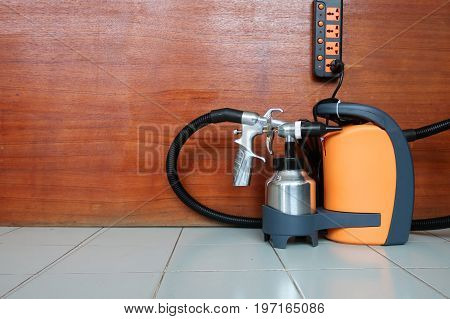 Electric sprayer with wooden wall for industry.