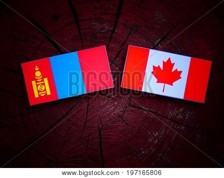Mongolian Flag With Canadian Flag On A Tree Stump Isolated